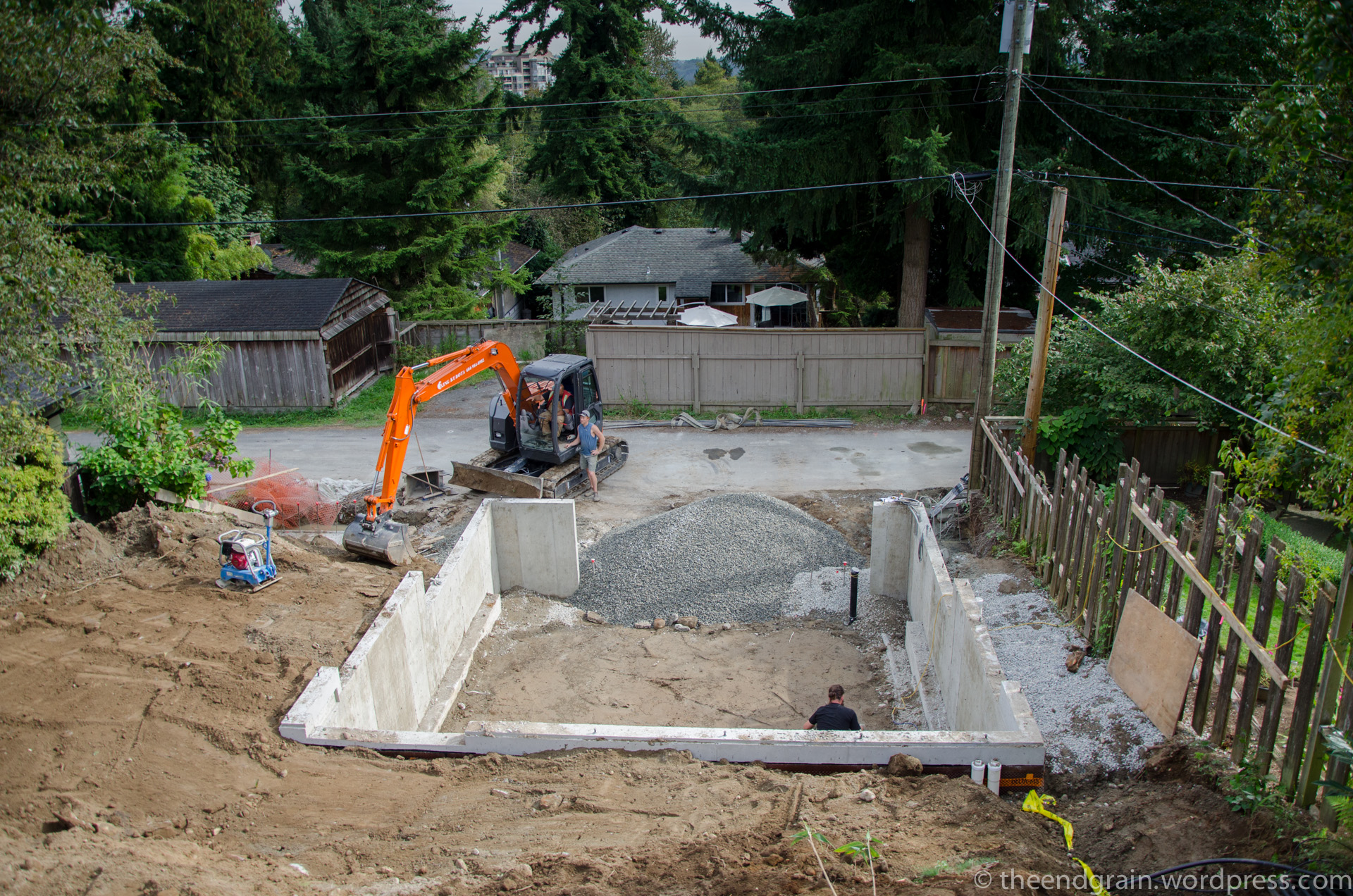 Backfill tamped with excavator bucket and compactor